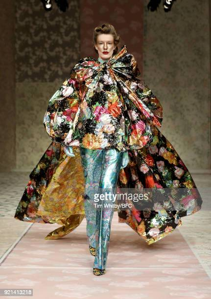 Model walks the runway at the Richard Quinn show during London Fashion Week February 2018 at BFC Show Space on February 20, 2018 in London, England.