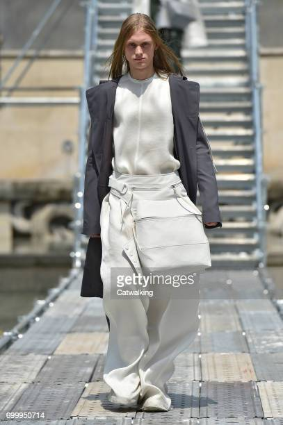A model walks the runway at the Rick Owens Spring Summer 2018 fashion show during Paris Menswear Fashion Week on June 22 2017 in Paris France