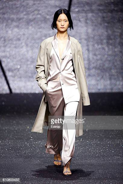 A model walks the runway at the Ricostru designed by Rico Manchit Au show Milan Fashion Week Spring/Summer 2017 on September 26 2016 in Milan Italy