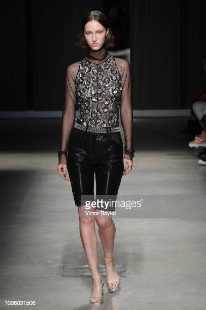 A model walks the runway at the Ricostru show during Milan Fashion Week Spring/Summer 2019 on September 19 2018 in Milan Italy