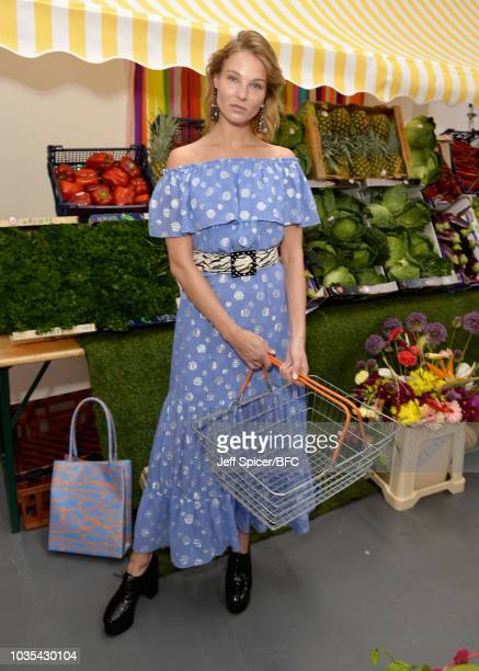 A model poses at the RIXO London presentation during London Fashion Week September 2018 at BFC Show Space on September 18 2018 in London England
