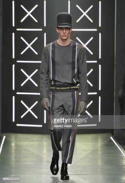 A model walks the runway at the Robert Geller fashion show during MercedesBenz Fashion Week Fall 2014 at Pier 59 on February 8 2014 in New York City