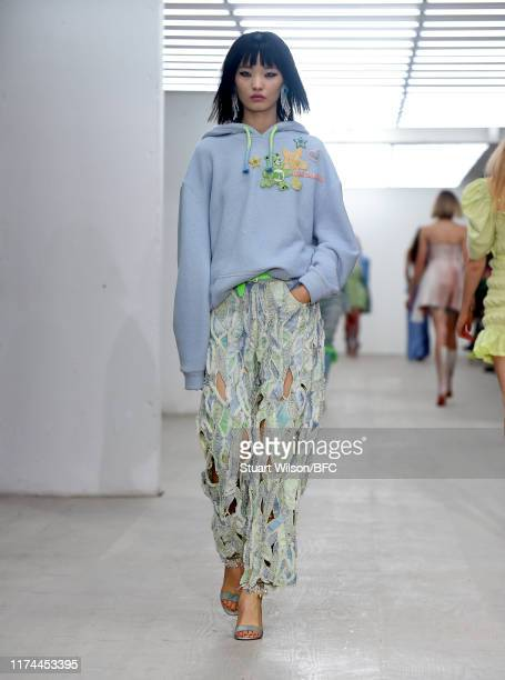 Model walks the runway at the Roberta Einer show during London Fashion Week September 2019 at the BFC Show Space on September 13, 2019 in London,...