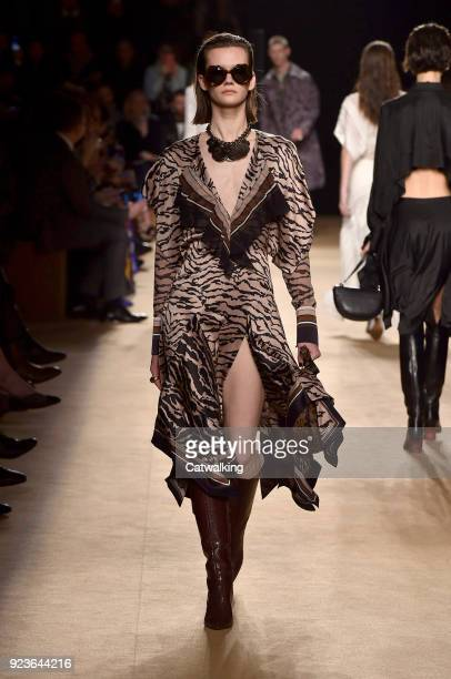 Model walks the runway at the Roberto Cavalli Autumn Winter 2018 fashion show during Milan Fashion Week on February 23, 2018 in Milan, Italy.