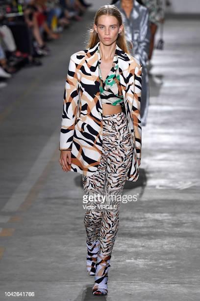 Model walks the runway at the Roberto Cavalli Ready to Wear fashion show during Milan Fashion Week Spring/Summer 2019 on September 22, 2018 in Milan,...