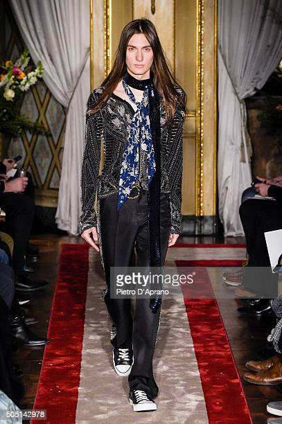 A model walks the runway at the Roberto Cavalli show during Milan Men's Fashion Week Fall/Winter 2016/17 on January 15 2016 in Milan Italy