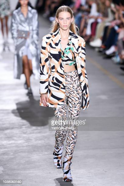 A model walks the runway at the Roberto Cavalli show during Milan Fashion Week Spring/Summer 2019 on September 22 2018 in Milan Italy