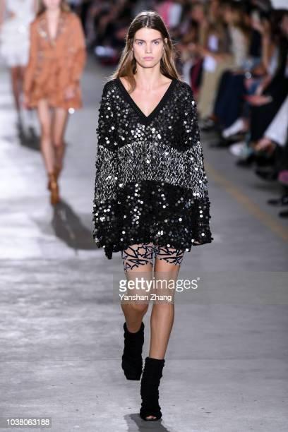 Model walks the runway at the Roberto Cavalli show during Milan Fashion Week Spring/Summer 2019 on September 22, 2018 in Milan, Italy.