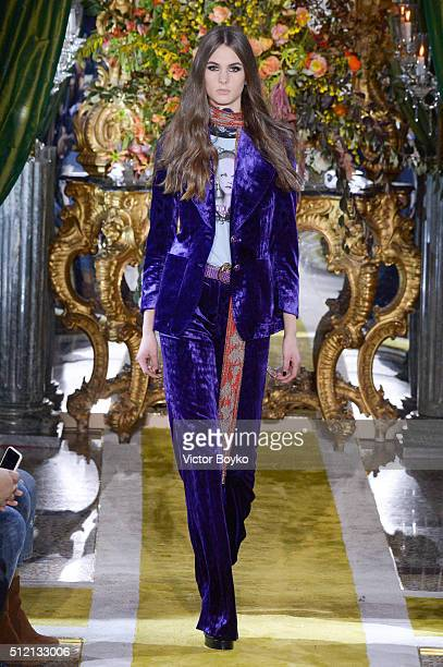 A model walks the runway at the Roberto Cavalli show during Milan Fashion Week Fall/Winter 2016/17 on February 24 2016 in Milan Italy