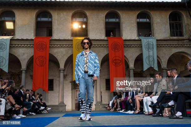 A model walks the runway at the Roberto Cavalli show during the 94th Pitti Immagine Uomo on June 13 2018 in Florence Italy
