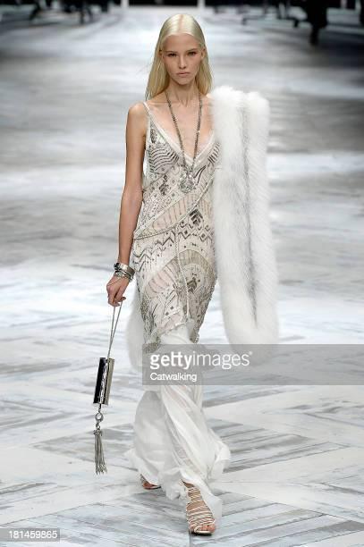 Model walks the runway at the Roberto Cavalli Spring Summer 2014 fashion show during Milan Fashion Week on September 21, 2013 in Milan, Italy.