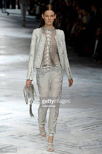 A model walks the runway at the Roberto Cavalli Spring Summer 2014 fashion show during Milan Fashion Week on September 21 2013 in Milan Italy