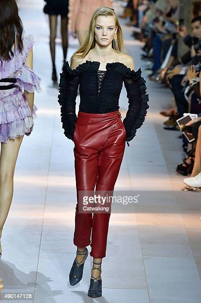 A model walks the runway at the Roberto Cavalli Spring Summer 2016 fashion show during Milan Fashion Week on September 26 2015 in Milan Italy