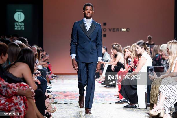 A model walks the runway at the 'Roberto Verino' catwalk during the MercedesBenz Madrid Fashion Week Spring/Summer in Madrid Spain July 09 2018
