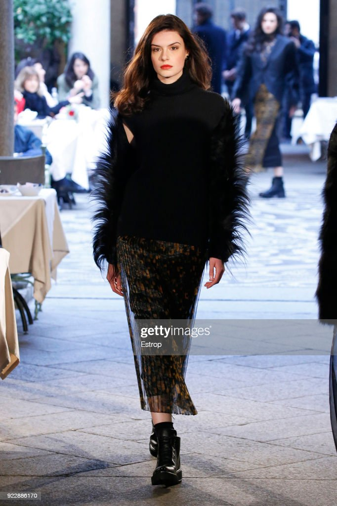 A model walks the runway at the Roccobarocco show during Milan Fashion Week Fall/Winter 2018/19 on February 21, 2018 in Milan, Italy.