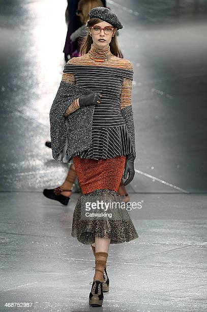 A model walks the runway at the Rodarte Autumn Winter 2014 fashion show during New York Fashion Week on February 11 2014 in New York United States