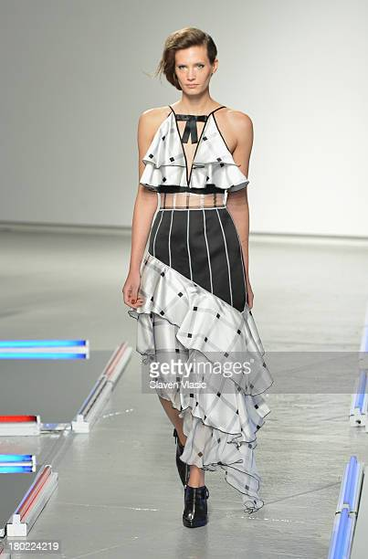 A model walks the runway at the Rodarte fashion show during MercedesBenz Fashion Week Spring 2014 on September 10 2013 in New York City