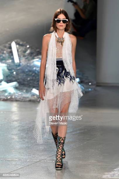 A model walks the runway at the Rodarte fashion show during MercedesBenz Fashion Week Spring 2015 on September 9 2014 in New York City