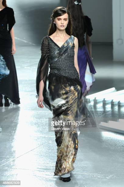A model walks the runway at the Rodarte fashion show during MercedesBenz Fashion Week Fall 2014 at Center 548 on February 11 2014 in New York City