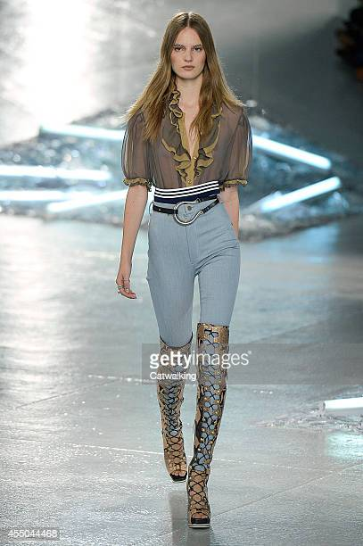 A model walks the runway at the Rodarte Spring Summer 2015 fashion show during New York Fashion Week on September 9 2014 in New York United States