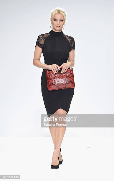 Model walks the runway at the Rohmir show at Fashion Scout during London Fashion Week Spring/Summer collections 2017 on September 17, 2016 in London,...