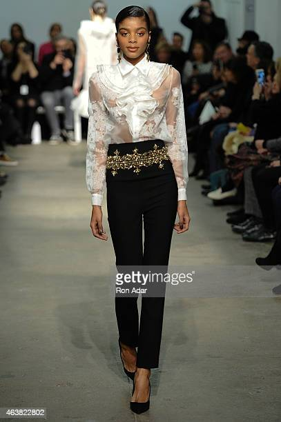 A model walks the runway at the Rolando Santana show during the MercedesBenz Fashion Week Fall 2015 at 344 West 38th Street on February 18 2015 in...