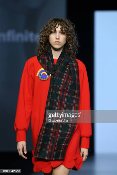 """Model walks the runway at the """"Rome Is My Runway"""" Collective Fashion Show during the Altaroma 2021 on February 19, 2021 in Rome, Italy."""