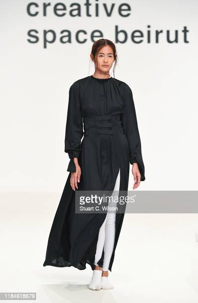 A model walks the runway at the Roni Helou and Hazem Kais show during the FFWD October Edition 2019 at the Dubai Design District on October 31 2019...