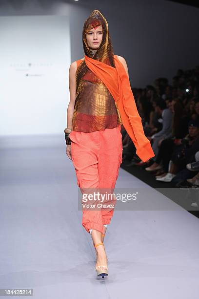 A model walks the runway at the Royal Closet Spring/Summer 2014 collection during the fourth day of MercedesBenz Fashion Week Mexico at Campo Marte...