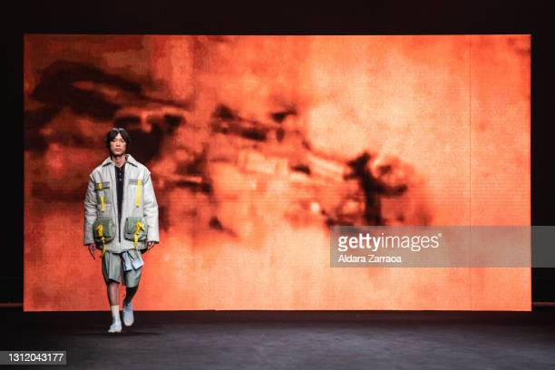 Model walks the runway at the Rubearth fashion show during Samsung EGO Mercedes Benz Fashion Week Madrid April 2021 at Ifema on April 11, 2021 in...