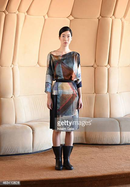 A model walks the runway at the Rubin Chapelle fashion show during MercedesBenz Fashion Week Fall 2015 at The Top of The Standard on February 13 2015...