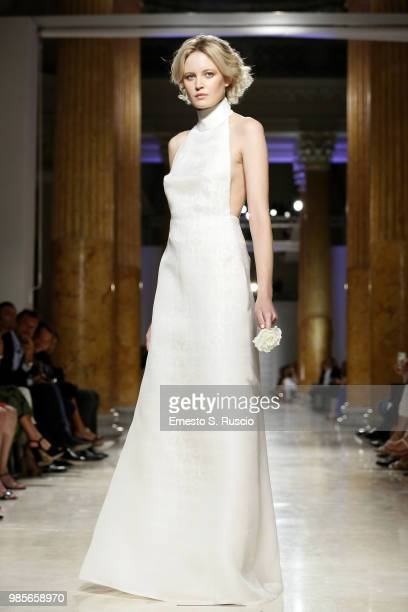 A model walks the runway at the Sabrina Persechino show during Altaroma at Palazzo delle Esposizioni on June 27 2018 in Rome Italy