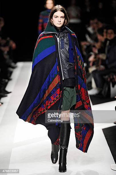 A model walks the runway at the Sacai Autumn Winter 2014 fashion show during Paris Fashion Week on March 3 2014 in Paris France