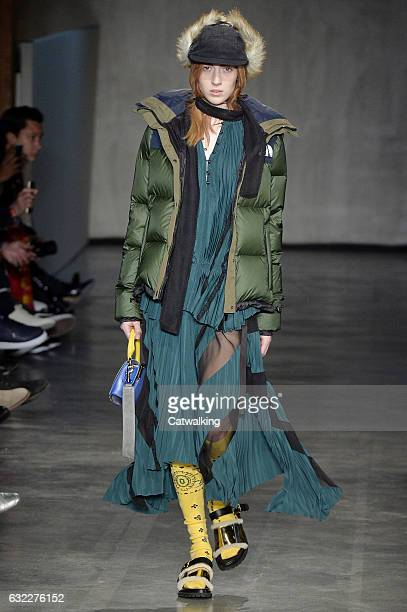 A model walks the runway at the Sacai Autumn Winter 2017 fashion show during Paris Menswear Fashion Week on January 21 2017 in Paris France