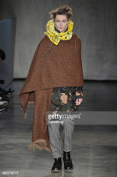 A model walks the runway at the Sacai Autumn Winter 2017 fashion show during Paris Menswear Fashion Week on January 21 2017 in Paris France