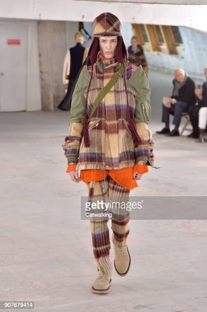 A model walks the runway at the Sacai Autumn Winter 2018 fashion show during Paris Menswear Fashion Week on January 20 2018 in Paris France