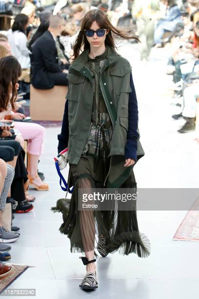 A model walks the runway at the Sacai show during Paris Men's Fashion Week Spring/Summer 2020 on June 22 2019 in Paris France