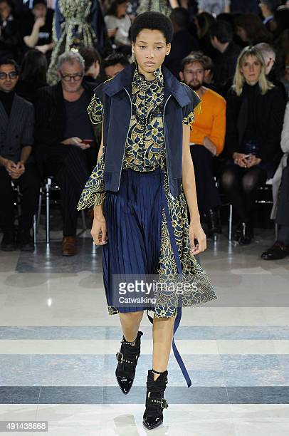 A model walks the runway at the Sacai Spring Summer 2016 fashion show during Paris Fashion Week on October 5 2015 in Paris France