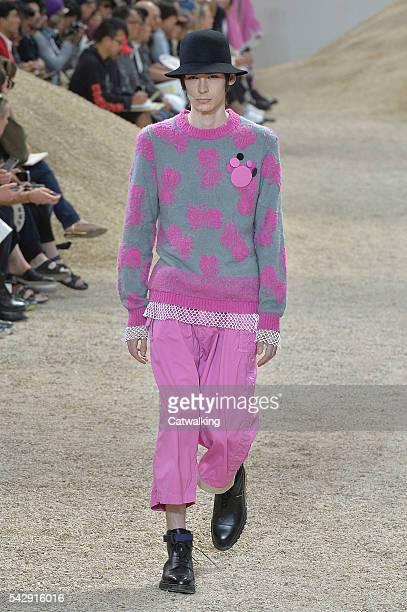 A model walks the runway at the Sacai Spring Summer 2017 fashion show during Paris Menswear Fashion Week on June 25 2016 in Paris France