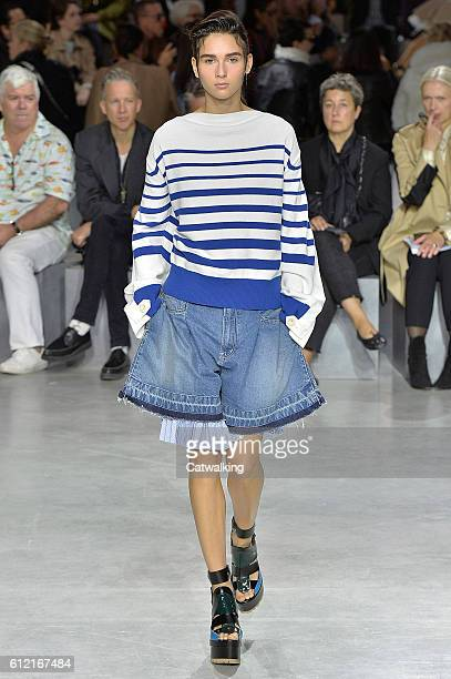 A model walks the runway at the Sacai Spring Summer 2017 fashion show during Paris Fashion Week on October 3 2016 in Paris France