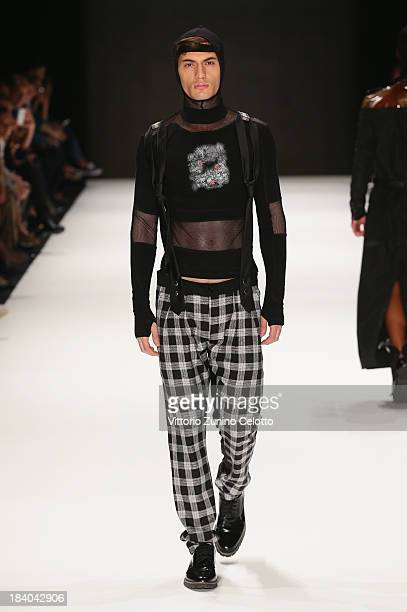 A model walks the runway at the Safak Tokur show during MercedesBenz Fashion Week Istanbul s/s 2014 Presented By American Express on October 11 2013...