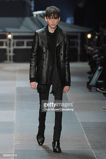 A model walks the runway at the Saint Laurent Autumn Winter 2013 fashion show during Paris Menswear Fashion Week on January 20 2013 in Paris France