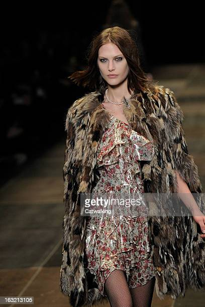 Model walks the runway at the Saint Laurent Autumn Winter 2013 fashion show during Paris Fashion Week on March 4, 2013 in Paris, France.