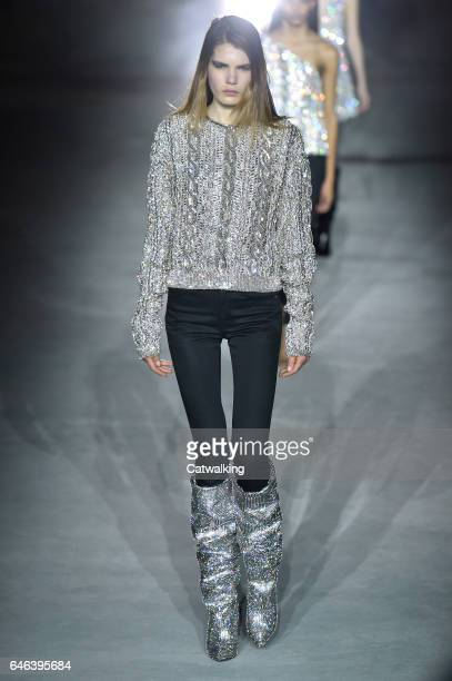 A model walks the runway at the Saint Laurent Autumn Winter 2017 fashion show during Paris Fashion Week on February 28 2017 in Paris France