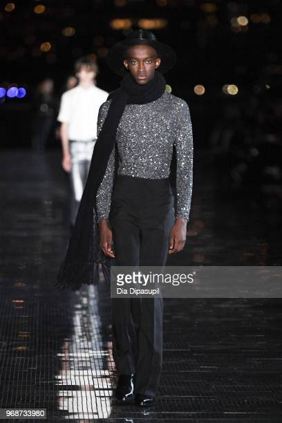 A model walks the runway at the Saint Laurent Resort 2019 Runway Show on June 6 2018 in New York City