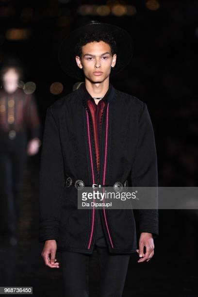 A model walks the runway at the Saint Laurent Resort 2019 Runway Show on June 6 2018 in New York City