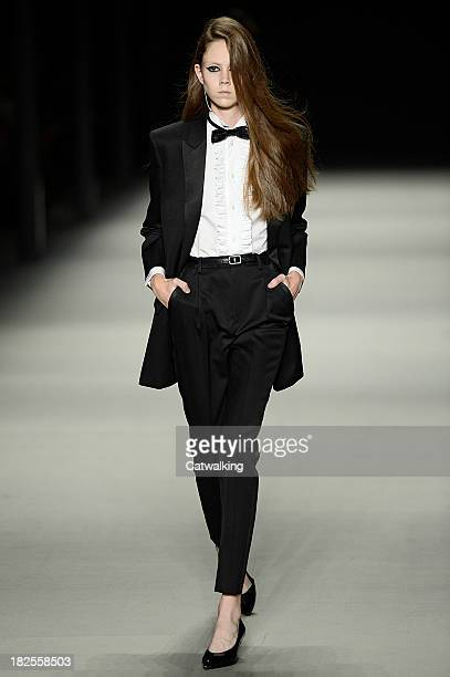 A model walks the runway at the Saint Laurent Spring Summer 2014 fashion show during Paris Fashion Week on September 30 2013 in Paris France