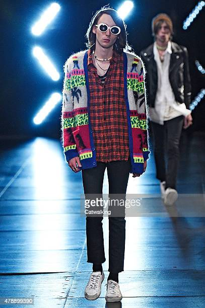 A model walks the runway at the Saint Laurent Spring Summer 2016 fashion show during Paris Menswear Fashion Week on June 28 2015 in Paris France