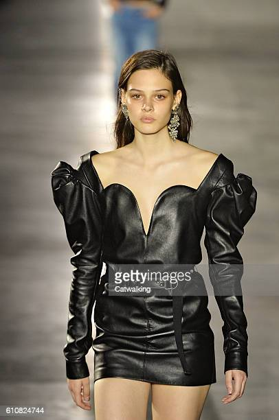 A model walks the runway at the Saint Laurent Spring Summer 2017 fashion show during Paris Fashion Week on September 27 2016 in Paris France
