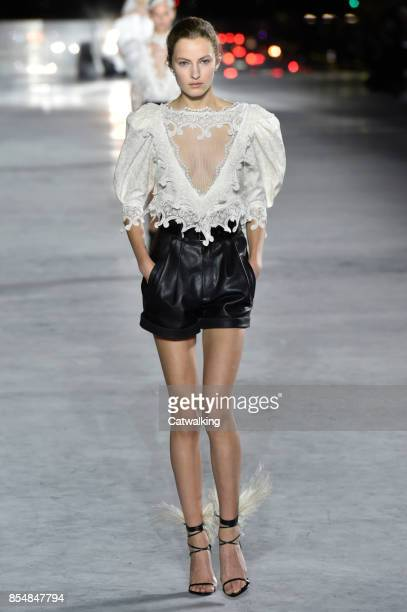 A model walks the runway at the Saint Laurent Spring Summer 2018 fashion show during Paris Fashion Week on September 26 2017 in Paris France